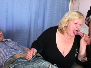 Busty fat grandma swallows two cocks at once