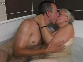 Mature slut mom takes young cock in the bathtub