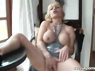 UK mature pornstar Jane Bond gets off in her study