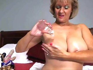 Oiled granny fucking her big pussy