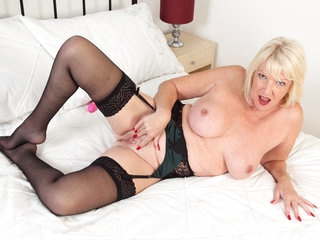 Buxom gilf Amy gets busy in lingerie with a dildo