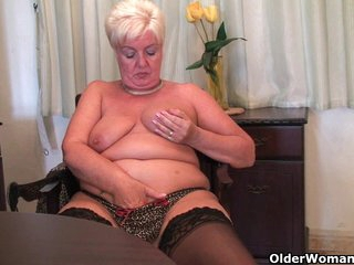 Chubby granny in stockings plays with vibrator