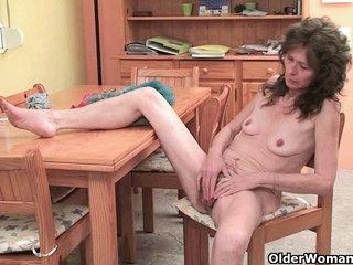 Granny with saggy tits and hairy pussy masturbates