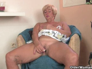 Old lady inserts dildo